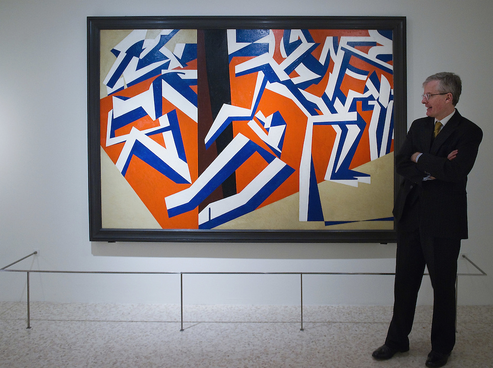 "VENICE, ITALY - JANUARY 28: The Director of the Peggy Guggenheim Collection Philip Rylands admires the painting by David Bomberg ""The Mud Bath "" at the press launch of the Vorticist exhibition on January 28, 2011 in Venice, Italy. The Vorticists: Rebel Artists in London and New York, 1914-1918, is the first exhibition devoted to Vorticism to be presented in Italy will be open at the Peggy Guggenheim Collection from  January 29 through May 15, 2011."