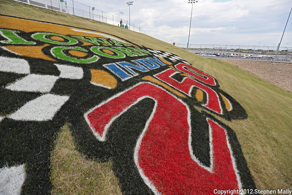 The logo on the grass before the start of the IZOD IndyCar Iowa Corn Indy 250 auto race at the Iowa Speedway in Newton, Iowa on Saturday, June 23, 2012.