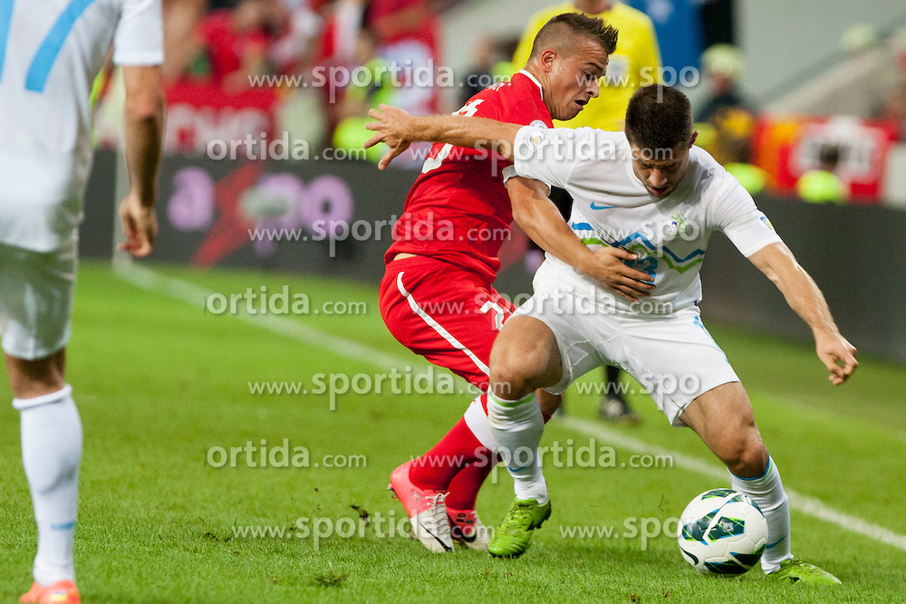 Stephan Lichtsteiner of Sweitterland and Bojan Jokic of Slovenia during qualifications football match for world cup 2014 in Brazil between national team of Slovenia and Switzerland, on September 7, 2012 in Ljubljana, Slovenia. (Photo by Urban Urbanc / Sportida.com)