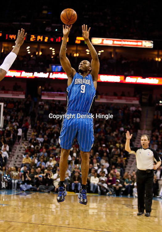 Feb 26, 2010; New Orleans, LA, USA; Orlando Magic forward Rashard Lewis (9) shoots against the New Orleans Hornets during the first half at the New Orleans Arena. The Hornets defeated the Magic 100-93. Mandatory Credit: Derick E. Hingle-US PRESSWIRE