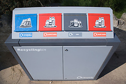 Recycling bin with compartments for Newspaper; magazine; plastic; bottles and cans