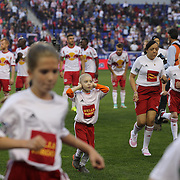 A young fan, who escorted Thierry Henry onto the pitch, reacts during the singing of the National Anthem before the New York Red Bulls Vs Houston Dynamo, Major League Soccer regular season match at Red Bull Arena, Harrison, New Jersey. USA. 4th October 2014. Photo Tim Clayton
