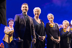 "© Licensed to London News Pictures . 12/01/2016 . Salford , UK . GARY BARLOW (pictured with the original Women's Institute members who made the calendar ) makes a surprise appearance and performs in front of the audience at the Lowry Theatre ,  during the opening week of "" The Girls "" , a musical he wrote based on the story "" Calendar Girls "" , about a group of Women's Institute members in Yorkshire , who made a nude calendar . Photo credit : Joel Goodman/LNP"