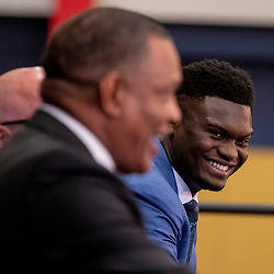 Jun 21, 2019; New Orleans, LA, USA; New Orleans Pelicans forward Zion Williamson the first overall selection in the NBA Draft smiles as head coach Alvin Gentry speaks during an introductory press conference at the New Orleans Pelicans Training Facility. Mandatory Credit: Derick E. Hingle-USA TODAY Sports