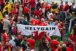 "LILLE, FRANCE - Friday, July 1, 2016: Wales fans hold up a banner ""Helygain"" in the centre of Lille ahead of the UEFA Euro 2016 Championship Quarter-Final match against Belgium at the Stade Pierre Mauroy. (Pic by Paul Greenwood/Propaganda)"
