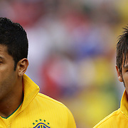 Hulk, (left) and Neymar, Brazil, during the team national anthems before the USA V Brazil International friendly soccer match at FedEx Field, Washington DC, USA. 30th May 2012. Photo Tim Clayton