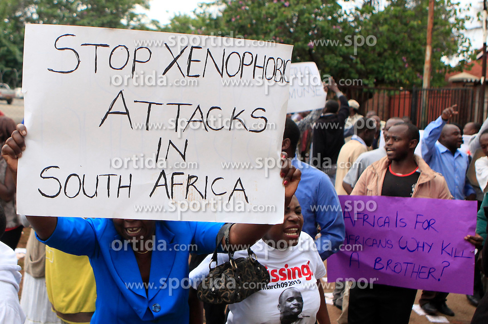 Zimbabwean people demonstrate against the xenophobic violence in South Africa outside the South African Embassy in Harare, Zimbabwe, April 17, 2015. EXPA Pictures &copy; 2015, PhotoCredit: EXPA/ Photoshot/ Xu Lingui<br /> <br /> *****ATTENTION - for AUT, SLO, CRO, SRB, BIH, MAZ only*****