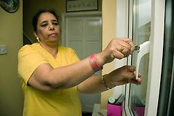 Older woman locking the front door,