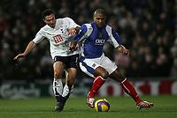 Photo: Lee Earle.<br /> Portsmouth v Tottenham Hotspur. The Barclays Premiership. 01/01/2007. Tottenham's Steed Malbranque (L) battles with Glen Johnson.