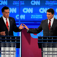 TAMPA, FL -- September 12, 2011 -- Republican Presidential candidates Gov. Mitt Romney and Gov. Rick Perry argue during the CNN/Tea Party Republican Debate at the Florida State Fairgrounds on Monday, September 12, 2011.  Eight Republican Presidential candidates squared off with host Wolf Blitzer in the battleground state of Florida for the 2012 Election.    (Chip Litherland for The New York Times)