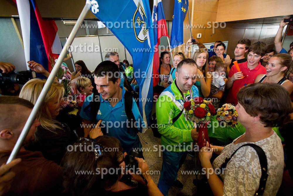Darko Duric and Francek Gorazd Tirsek of Team Slovenia at arrival to Airport Joze Pucnik after the London 2012 Paralympic Games on September 10, 2012, in Brnik, Slovenia. (Photo by Vid Ponikvar / Sportida.com)