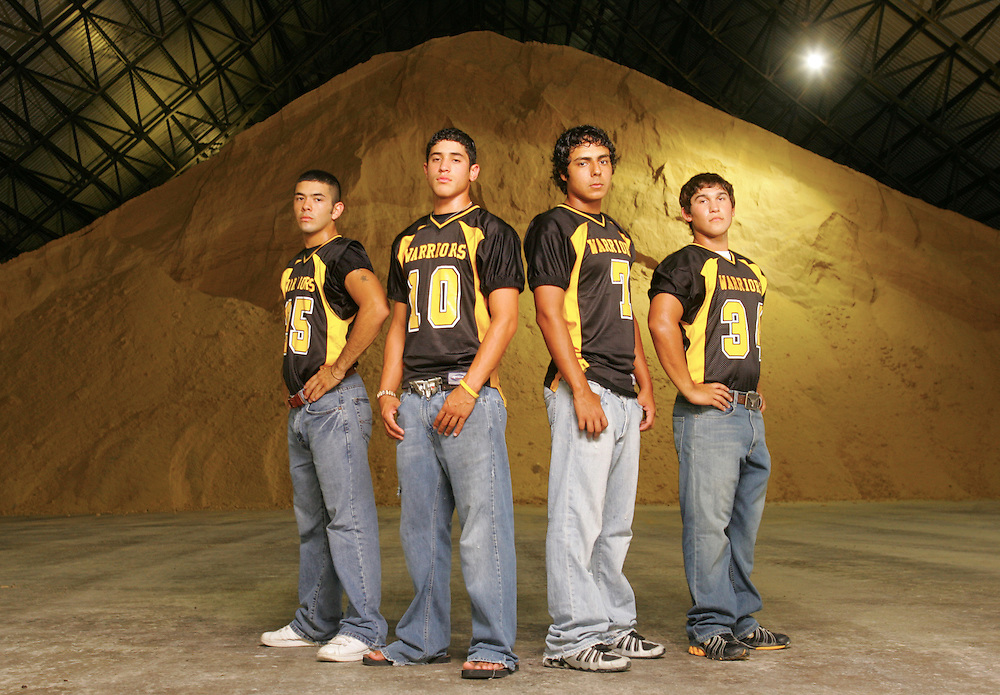 Photo by Alex Jones..Santa Rosa Warriors: #25 Larry Gonzales, receiver, #10 Javier Vasquez, receiver, #7 Fabian Zuniga, quarterback, #34 Sam Salazar, running back.  Shot at Cowley Sugar House in Santa Rosa.