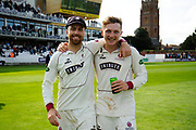 Jack Leach of Somerset and Dom Bess of Somerset on a lap of honour after beating Middlesex to secure survival in Division 1 of the Specsavers County Champ Div 1 match between Somerset County Cricket Club and Middlesex County Cricket Club at the Cooper Associates County Ground, Taunton, United Kingdom on 28 September 2017. Photo by Graham Hunt.