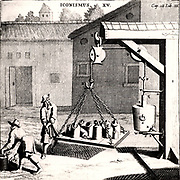 Demonstrating the strength of a vacuum. Vessel from which air has been evacuated mounted in frame.  A rope attached is passed over two pulley wheels.  On a wooden platform hung from the end of the rope weights were added until the vacuum was overpowered.  From 'Experimental Nova' by Otto von Guericke (Amsterdam, 1672).  Engraving.