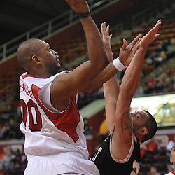 Dec 20, 2008; Piscataway, NJ, USA; Rutgers forward Gregory Echenique (00) drives to the net through Bryant center Nick Pontes (23) during the first half of Rutgers' 67-37 victory at the Louis Brown Rutgers Athletic Center.