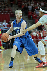 26 February 2014:  Lucas Eitel looks for a move around Zach Lofton during an NCAA Missouri Valley Conference (MVC) mens basketball game between the Indiana State Sycamores and the Illinois State Redbirds  in Redbird Arena, Normal IL.