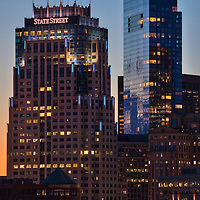 Boston skyline photography showing the Boston State Street Corporation and Millennium Tower on a magnificent night at sunset. This Boston blue hour skyline photo is available as museum quality photography prints, canvas prints, acrylic prints or metal prints. Fine art prints may be framed and matted to the individual liking and decorating needs:<br />  <br /> https://juergen-roth.pixels.com/featured/boston-state-street-corporation-and-millennium-tower-juergen-roth.html<br /> <br /> All photographs are available for digital and print image licensing at www.RothGalleries.com. Please contact me direct with any questions or request.<br /> <br /> Good light and happy photo making!<br /> <br /> My best,<br /> <br /> Juergen<br /> Prints: http://www.rothgalleries.com<br /> Photo Blog: http://whereintheworldisjuergen.blogspot.com<br /> Twitter: @NatureFineArt<br /> Instagram: https://www.instagram.com/rothgalleries<br /> Facebook: https://www.facebook.com/naturefineart