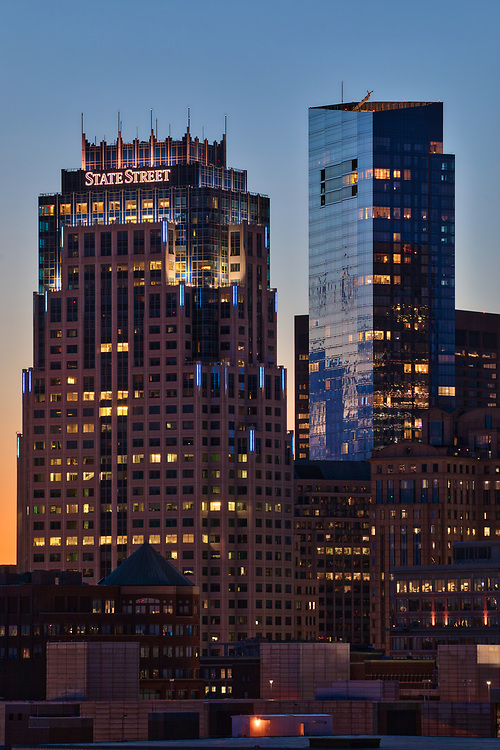 Boston skyline photography showing the Boston State Street Corporation and Millennium Tower on a magnificent night at sunset. This Boston blue hour skyline photo is available as museum quality photography prints, canvas prints, acrylic prints or metal prints. Fine art prints may be framed and matted to the individual liking and decorating needs:<br />