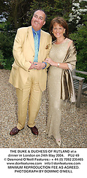 THE DUKE & DUCHESS OF RUTLAND at a dinner in London on 24th May 2004.PUJ 49