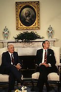 President H W Bush and Mikhail Gorbachev meet in the Oval Office in June 1990..Photograph by Dennis Brack bb30
