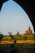 A monastery complex seen through an ancient doorway in Bagan, Burma (Myanmar)