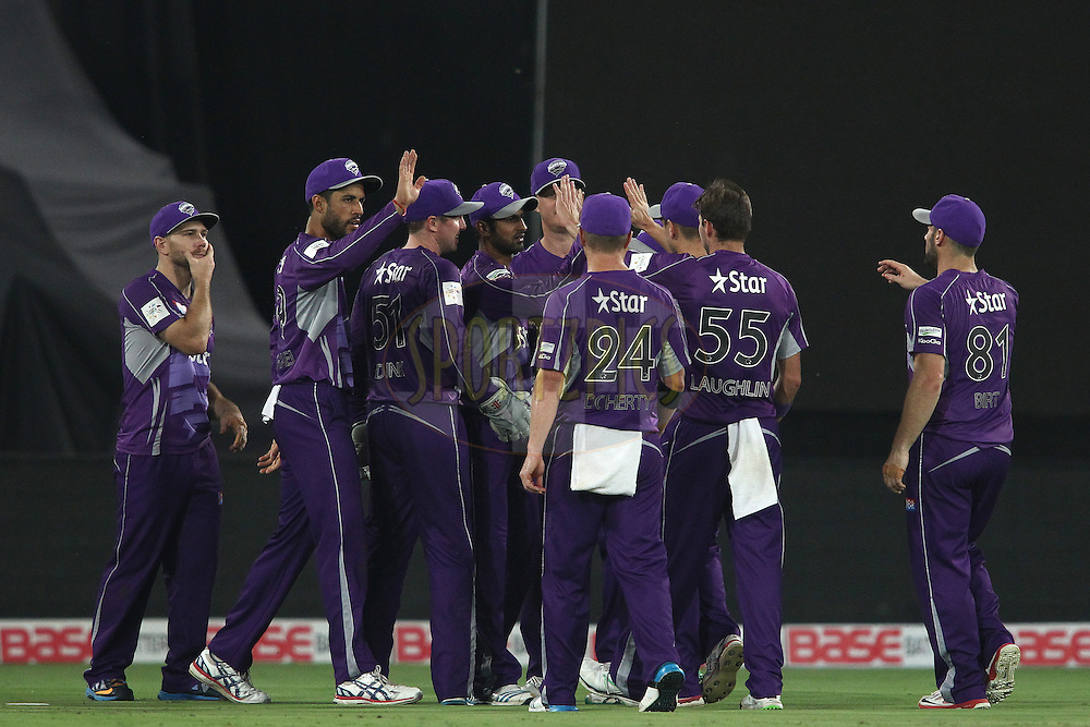 Shoaib Malik of the Hobart Hurricanes and Ben Laughlin of the Hobart Hurricanes are congratulated for getting Manish Pandey of the Kolkata Knight Riders wicket during the first semi final match of the Oppo Champions League Twenty20 between the Kolkata Knight Riders and the Hobart Hurricanes held at the Rajiv Gandhi Cricket Stadium, Hyderabad, India on the 2nd October 2014<br /> <br /> Photo by:  Shaun Roy / Sportzpics/ CLT20<br /> <br /> <br /> Image use is subject to the terms and conditions as laid out by the BCCI/ CLT20.  The terms and conditions can be downloaded here:<br /> <br /> http://sportzpics.photoshelter.com/gallery/CLT20-Image-Terms-and-Conditions-2014/G0000IfNJn535VPU/C0000QhhKadWcjYs