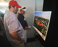 Kirk Wood, left, and Tim Rouse look over drawings of the proposed expansion of the University of Mississippi's Vaught-Hemingway Stadium during a presentation in Oxford, Miss. on Tuesday, AUgust 9, 2011. The university announced a $150 million capital improvement campaign to build a new basketball arena and expand Vaught-Hemingway Stadium. (AP Photo/Oxford Eagle, Bruce Newman)
