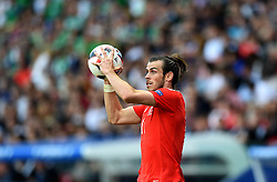Gareth Bale of Wales takes a throw in  - Mandatory by-line: Joe Meredith/JMP - 25/06/2016 - FOOTBALL - Parc des Princes - Paris, France - Wales v Northern Ireland - UEFA European Championship Round of 16