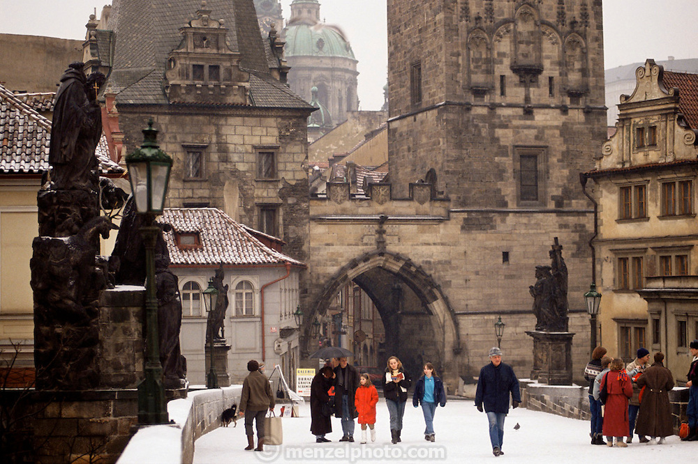 Charles Bridge in winter with snow. Prague, Czech Republic.