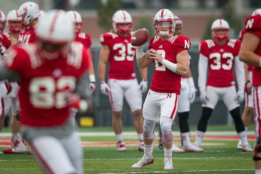 April 8, 2015: Zack Darlington #2 throws the ball to Alonzo Moore  #82 during practice at the Hawks Championship Center in Lincoln, Nebraska.