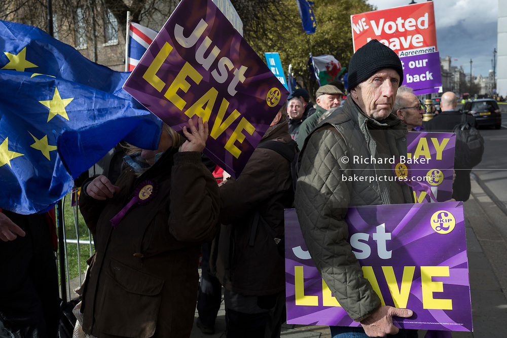 On the day that MPs in Parliament vote on a possible delay on Article 50 on EU Brexit negotiations by Prime Minister Theresa May, UKIP Leavers protest on College Green, on 14th March 2019, in Westminster, London, England.