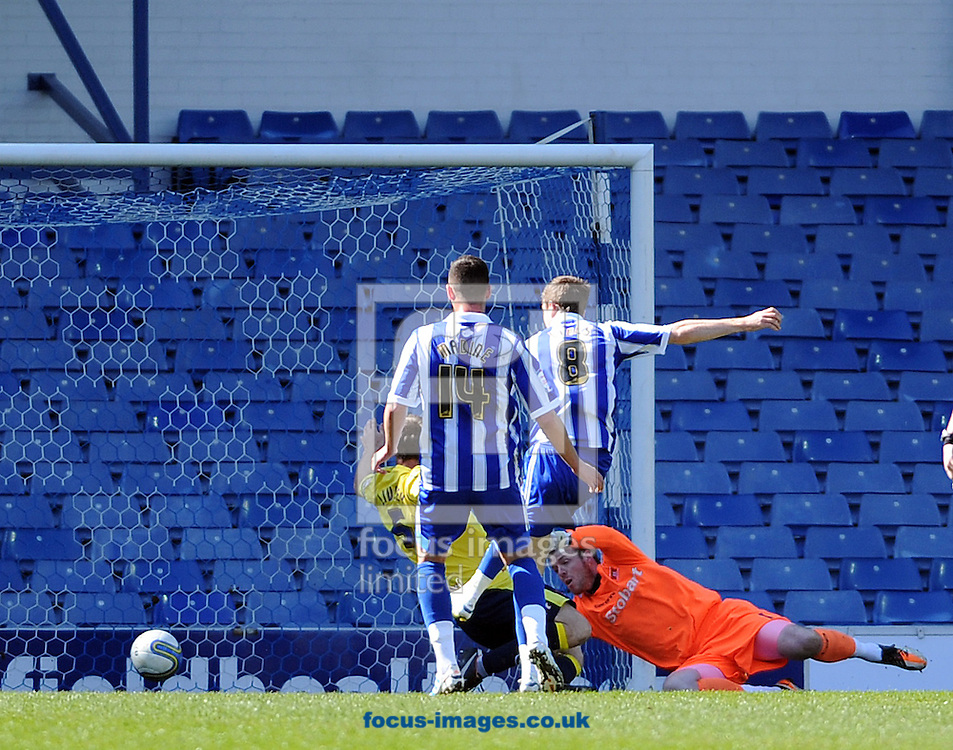 Picture by Graham Crowther/Focus Images Ltd. 07763140036.21/04/12.Chris Lines of Sheffield Wednesday scores the opening goal agasinst Carlisle United during the Npower League 1 game at Hillsborough stadium, Sheffield