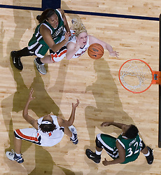 Virginia Cavaliers Forward/Center Abby Robertson (30) goes up for a defensive rebound against Charlotte.  The Virginia Cavaliers women's basketball team defeated The University of North Carolina - Charlotte 49ers 74-72 in the 2nd round of the Women's NIT at John Paul Jones Arena in Charlottesville, VA on March 19, 2007.