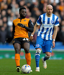 Wolverhampton Wanderers' Nouha Dicko is tackled by Brighton and Hove Albion's Bruno Saltor  - Photo mandatory by-line: Harry Trump/JMP - Mobile: 07966 386802 - 14/03/15 - SPORT - Football - Sky Bet Championship - Brighton v Wolves - Amex Stadium, Brighton, England.