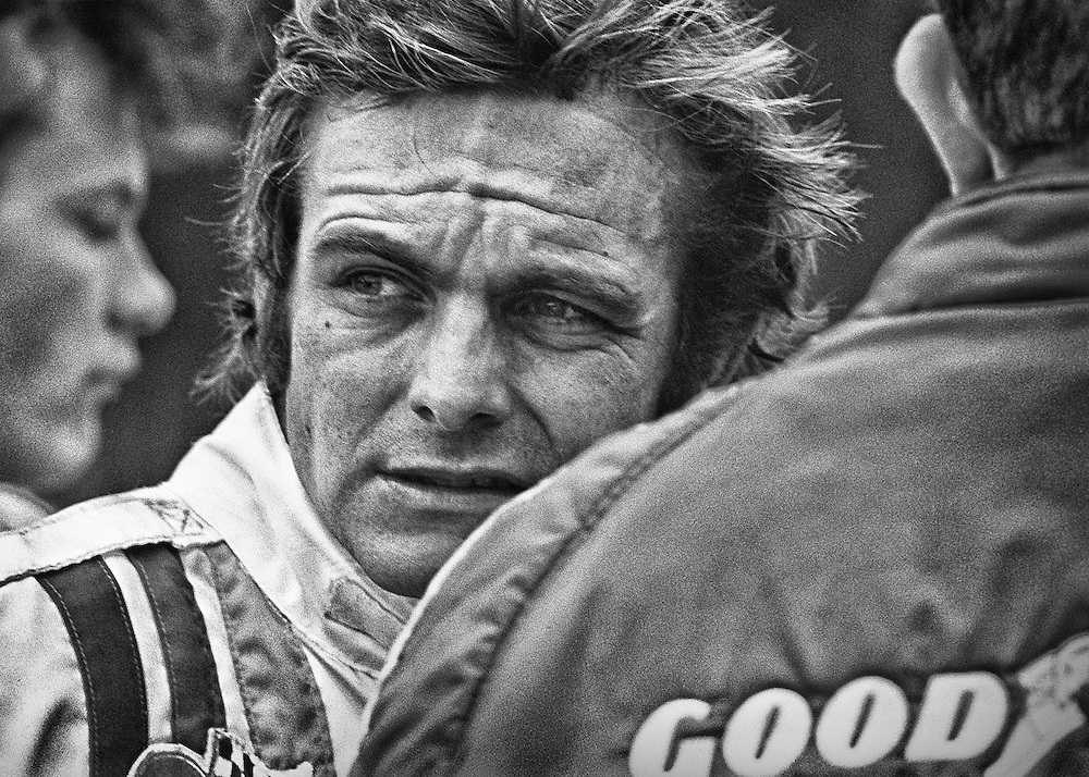 American Peter Revson, seen here during practice for the 1972 United States Grand Prix, seemed to have positioned himself for F1 stardom by the fall of that year. He had surprised everyone with his pole position and 2nd place finish at the Indianapolis 500 in 1971, and went on to also capture that year's Can-Am Championship, both times driving for McLaren. <br />