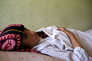 This 16 year old girl from the Ragh district gave birth to her first baby a day before but still is in very bad shape and recovering in Faizabad Provincial hospital. In prolonged and obstructed labour, she was lucky to reach the hospital in time and receive a c-section. Most maternal deaths in Afghanistan happen in remote areas like Badakshan province because it takes women days to reach skilled staff to help delivery when complications arise. Afghanistan, 2012
