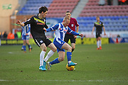 David Perkins &  Sam Hart battle for possession during Wigan Athletic and Rochdale match at the DW Stadium, Wigan, England on 24 February 2018. Picture by Myriam Cawston.