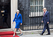 UNITED KINGDOM, London: 04 June 2019 <br /> British Prime Minister Theresa May leads the way for The President of the United States of America Donald Trump as they arrive at 10 Downing Street this morning during The President's official state visit.