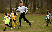 Cory Booker plays soccer with kids at a campaign stop in 2002.