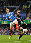 Portsmouths Conor Chaplin beats Mansfield Towns Nicky Hunt to the ball during the Sky Bet League 2 match between Portsmouth and Mansfield Town at Fratton Park, Portsmouth, England on 24 October 2015. Photo by Adam Rivers.