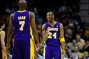 Feb. 16, 2011; Cleveland, OH, USA; Los Angeles Lakers shooting guard Kobe Bryant (24) talks with Los Angeles Lakers power forward Lamar Odom (7) during the third quarter against the Cleveland Cavaliers at Quicken Loans Arena. The Cavaliers beat the Lakers 104-99. Mandatory Credit: Jason Miller-US PRESSWIRE