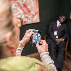 London, UK - 15 October 2014: a visitor takes a photo at the Sleeping Guard by Christoph Buchel  performs at the Hauser & Wirth stand during the first day of Frieze Art Fair and Frieze Masters in Regent's Park.