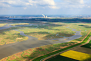Nederland, Zeeland, Zeeuws-Vlaanderen, 09-05-2013; geulen, slikken en schorren in het Verdronken Land van Saeftinghe, getijdengebied in het oosten Zeeuws-Vlaanderen op de grens met Belgie en onderdeel van het estuarium van de Schelde. Hertogin Hedwigepolder en haven Antwerpen met kerncentrale Doel in de achtergrond. De voormalige polder is het grootste brakwatergebied van Europa en staat onder invloed van het getij. Het Verdronken Land is een natuurreservaat, in beheer bij het Zeeuws Landschap en belangrijk als broed-, overwinterings- en rustgebied voor vogels. Niet vrij toegankelijk. .The Drowned Land of Saeftinghe, tidal area in the east of Dutch Flanders on the border with Belgium. Hertogin Hedwigepolder and Antwerp port with nuclear power station Doel in the background. The former polder is the largest brackish water of Europe and because of the the tides, there are mud flats and gullies. The Drowned Land is a nature reserve, not freely accessible. It is managed by the Zeeuws Landscape and important as bird sanctuary, part of the Scheldt estuary..luchtfoto (toeslag op standard tarieven).aerial photo (additional fee required).copyright foto/photo Siebe Swart