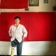 At the age of 19, Zung Ming lost his right leg fighting Communists in Thailand's PhitsanUlok Provence. He is part of the Community of Mae Salong, a group of Chinese refugees who fought Communists in SE asia before settling in a remote area at the end of the Himalayas years after their exile. Behind him are photos of leaders of the group, and a Taiwanese flag. Mae Salong feels great solidarity with the island, because of their own fight for independence.