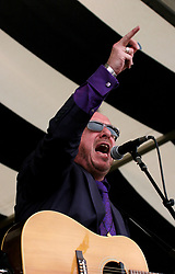 30 April 2006. New Orleans, Louisiana. Jazzfest . <br /> The first New Orleans Jazz and Heritage festival following the disaster of Hurricane Katrina. <br /> Music legend and icon Elvis Costello makes a guest appearance with Alan Toussaint on the Acura stage.<br /> <br /> Photo ©Charlie Varley/varleypix.com<br /> All rights reserved.