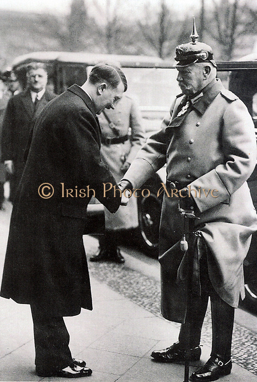 German Chancellor Adolph Hitler greeting  President Paul von Hindenberg, 1933.