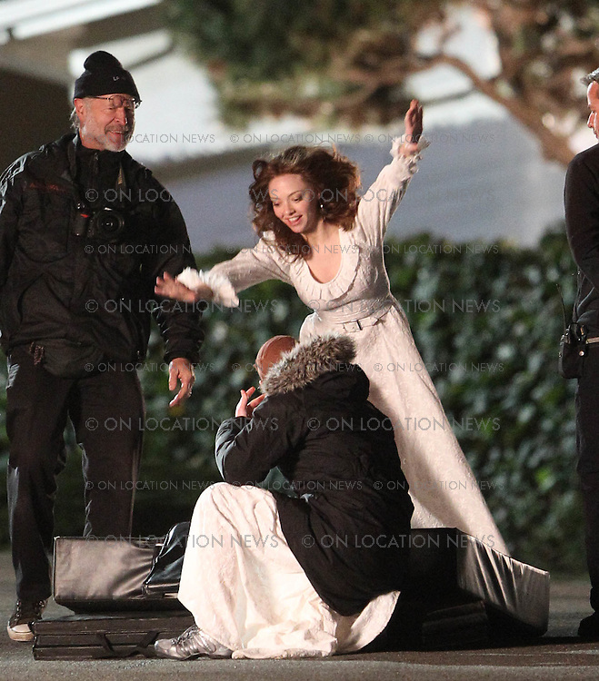 January 22nd 2012 Redondo Beach, CA. ***EXCLUSIVE*** Amanda Seyfried is chased down the street by Peter Sarsgaard while filming a scene for Lovelace. Seyfried appeared to have fun rehearsing  with her stunt woman falling onto a stunt pad for her scene. Photo by Eric Ford/ On Location News 1/818-613-3955 info@onlocationnews.com