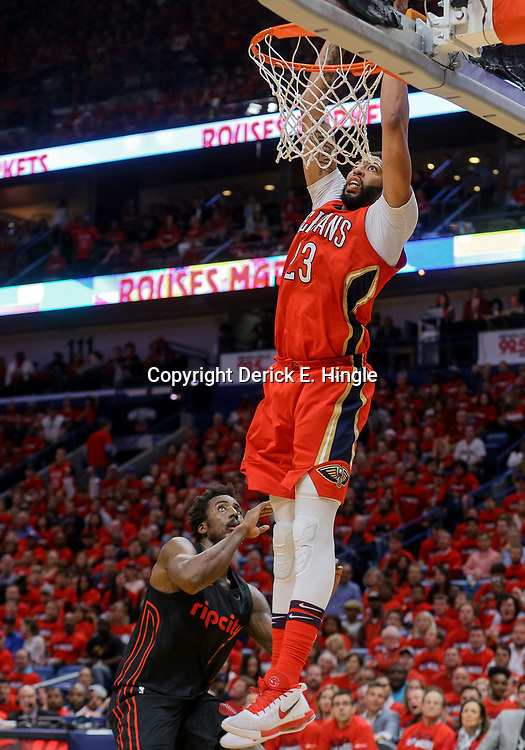 Apr 19, 2018; New Orleans, LA, USA; New Orleans Pelicans forward Anthony Davis (23) dunks over Portland Trail Blazers forward Al-Farouq Aminu (8) during the second quarter in game three of the first round of the 2018 NBA Playoffs at the Smoothie King Center. Mandatory Credit: Derick E. Hingle-USA TODAY Sports