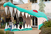 Children play in the giant alligator mouth at the entrance to Gatorland theme park and wildlife preserve located along South Orange Blossom Trail in Orlando, Florida. It was founded by Owen Godwin in 1949.