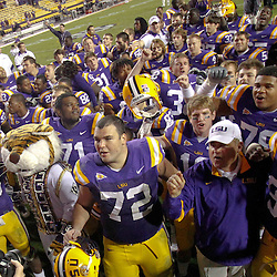 November 12, 2011; Baton Rouge, LA, USA;  LSU Tigers head coach Les Miles and player celebrate following a win over the Western Kentucky Hilltoppers during the second half of a game at Tiger Stadium. LSU defeated Western Kentucky 42-9. Mandatory Credit: Derick E. Hingle-US PRESSWIRE